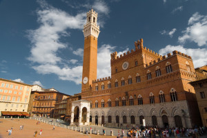 Tower of Town hall in Siena with part of square